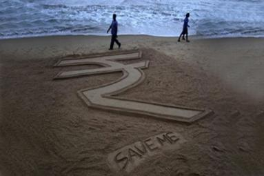 Rupee fall: NRIs take loans to remit money